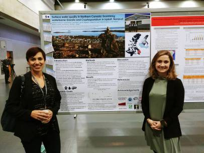 Jean Allen (left) and Stephanie Masina (right) with their poster on water quality and contaminants in Iqaluit, NU; photo credit - Stephanie Masina.
