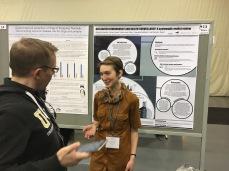 Alexandra Sawatzky (right) presenting her poster to Dr. Dan Gillis (right) - Sherilee Harper.