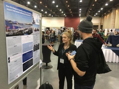 Jacqueline Middleton (left) presenting her poster to Dr. Jason Ernst.